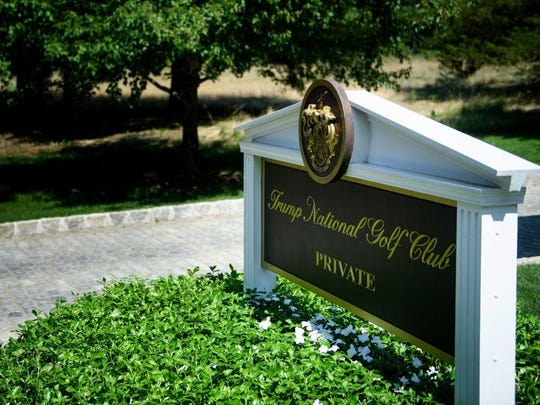 A sign is seen at an entrance to the Trump National Golf Club August 9, 2018 in Bedminster, New Jersey. A lawyer for a dozen workers at the club who are in the United States illegally says they were fired this month even though managers knew of their illegal status years ago.