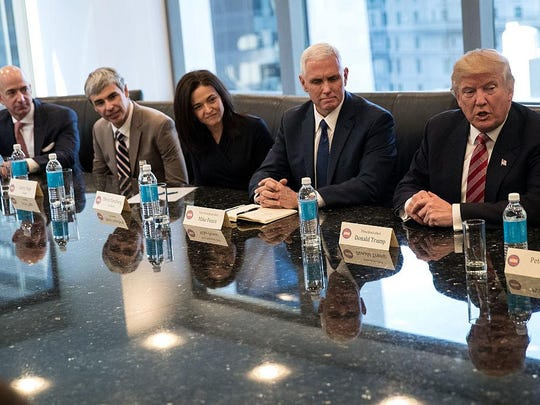 Jeff Bezos, from left, chief executive officer of Amazon, Larry Page, chief executive officer of Alphabet Inc., Sheryl Sandberg, chief operating officer of Facebook, Vice President-elect Mike Pence listen as President-elect Donald Trump speaks during a meeting of technology executives at Trump Tower, December 14, 2016 in New York City.