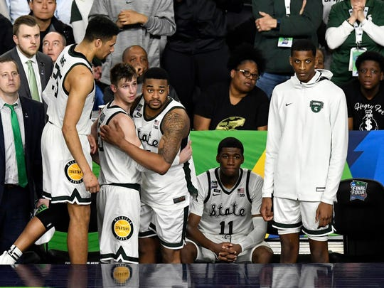 Michigan State's players, including Matt McQuaid and Nick Ward, watch the end of their Final Four loss to Texas Tech.