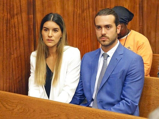 Mexican soap opera star Pablo Lyle, right, and his wife Ana Araujo wait before appearing in Miami-Dade, Fla., circuit court on Monday, April 8, 2019. A Florida judge has set bail at $50,000 and ordered house arrest for Pablo Lyle who is accused of punching a man who later died.