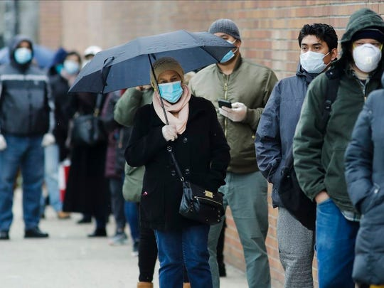People line up at Gotham Health East New York, a COVID-19 testing center Thursday, April 23, 2020, in the Brooklyn borough of New York.