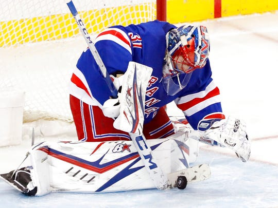 New York Rangers goaltender Igor Shesterkin (31) makes a save during the third period of an NHL hockey game against the Columbus Blue Jackets, Sunday, Jan. 19, 2020, in New York. The Blue Jackets defeated the Rangers 2-1.
