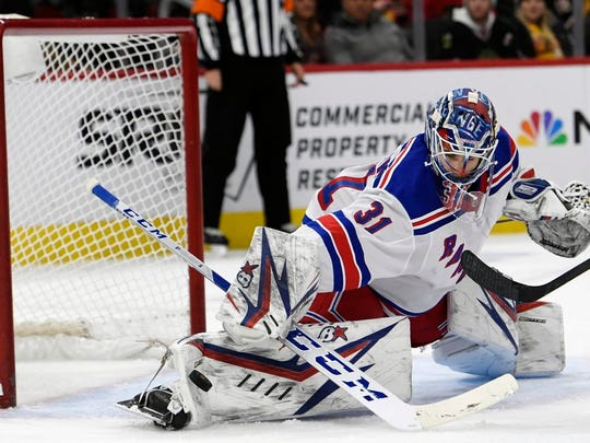 New York Rangers goalie Igor Shesterkin (31) of Russia, makes a save during the third period of an NHL hockey game against the Chicago Blackhawks Wednesday, Feb. 19, 2020, in Chicago.