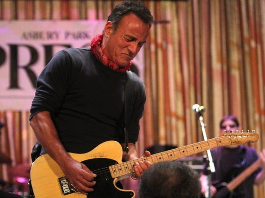 Bruce Springsteen performing during a Light of Day event in Asbury Park, 2014.