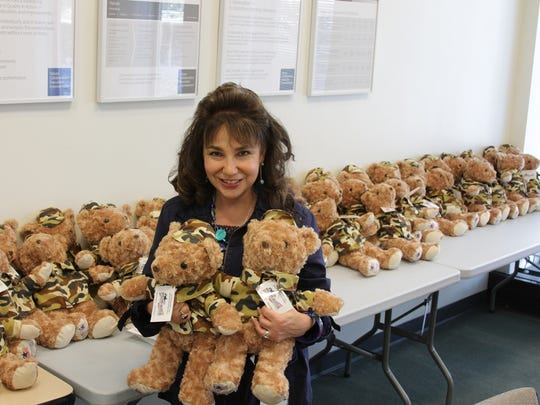 Mary Ann O'Herron Celelli holds a few of the teddy bears that will be sent to families of deployed U.S. service men and women as part of Operation Gratitude.