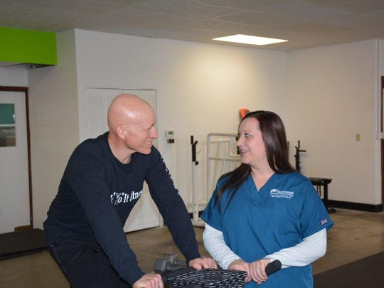 KinderAn Duerst, a nursing student at Northeast Wisconsin Technical College, waits to take the pulse of her dad, Don Poore, owner of Stick To It Fitness in Algoma, who is a 2010 small business management graduate of NWTC.