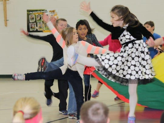 All of the students at Madison Elementary School participated in a Harvest dance recently that was organized by the physical education teachers. Pictured are second graders dancing.