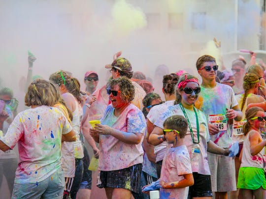 "Color Craze participants arrive at the ""Last Blast Zone"" spattered, sprayed and sprinkled with bright, nontoxic paints."