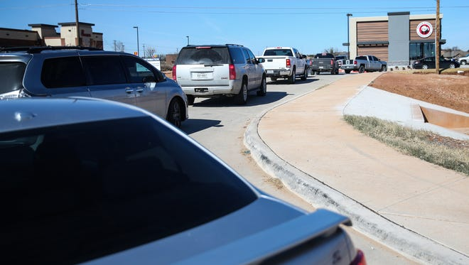 A line of cars reaches the street during lunch time Wednesday, Jan. 3, 2018, at Panda Express.