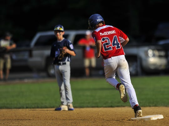 South Wall's Colin Mac Dermant rounds the bases after hitting a three-run home run in the first inning during a game against Lincroft in the Little League Section 3 Tournament at Van Horn Park in Mercerville on July 18, 2017.