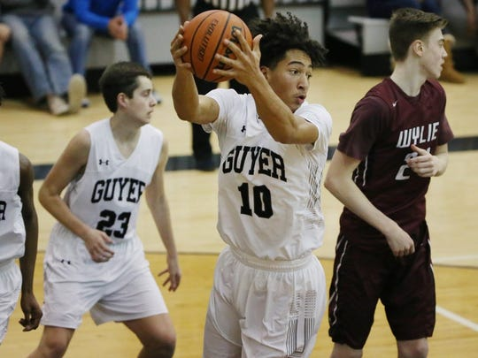 Guyer's Jalen Wilson grabs a defensive rebound in the