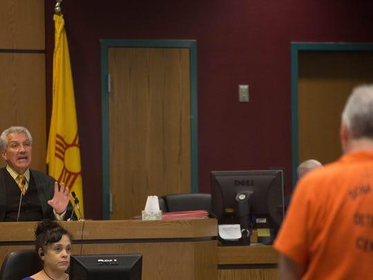 Judge Fernando Macias, left, of the 3rd Judicial District
