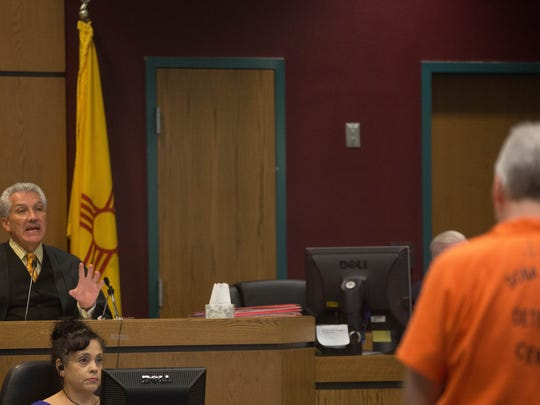 """Judge Fernando Macias, left, of the 3rd Judicial District Court, sentenced John Gose, right, to four years behind bars and five years probation on drug charges on Wednesday July 19, 2017. """"You should be held to a higher standard,"""" the judge told Gose, a former teacher in Las Cruces and El Paso."""