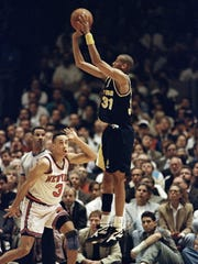 Indiana Pacers guard Reggie Miller (33) shoots over New York Knicks guard John Starks (3) in the third quarter of game five of the Eastern Conference Finals Wednesday, June 1, 1994, in New York's Madison Square Garden. Miller scored 25 of his 39 points in the fourth quarter, rallying the Pacers to a 93-86 victory over the New York Knicks and a 3-2 lead in the Eastern conference finals. (AP Photo/Kathy Willens)