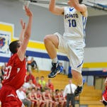 Oconto senior Jakob Jarvey on a drive to the basket just a moment before he suffered a season-ending knee injury.