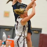 Oconto's Kelly Stewart fights for a rebound in the game Thursday against NEW Lutheran.