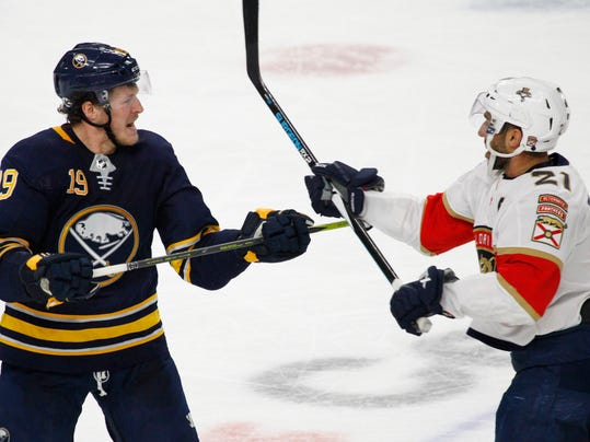 Buffalo Sabres Jake McCabe (19) and Florida Panthers Vincent Trocheck (21) exchange words during the third period of an NHL hockey game, Thursday, Feb. 1, 2018, in Buffalo, N.Y. (AP Photo/Jeffrey T. Barnes)