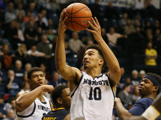 Monmouth Hawks guard Micah Seaborn (10) goes to the