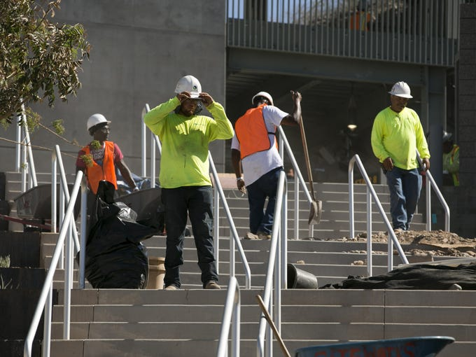 Construction workers work on the stairs leading up