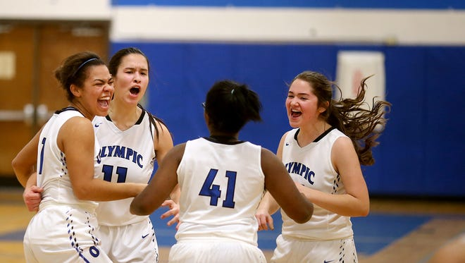 Olympic's Katie Campana top left celebrates with her teammates after she made two free throws to beat Port Angeles on Friday night at Olympic.
