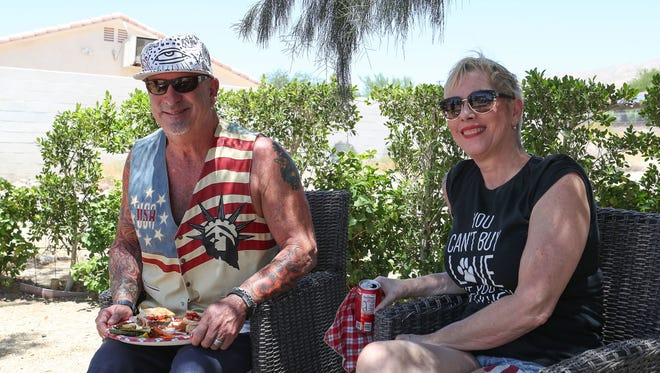 Steve and Lori Thornberry enjoy the outdoors at the Desert Hot Springs Inn during a cannabis independence day party on July 4, 2018.