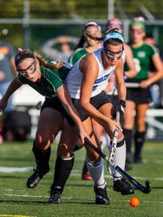 Mount Pleasant's Elizabeth McCole (left) tries to fight the ball away from Middletown's Madison Cook (right) in the second half of Middletown's 4-2 win over Mount Pleasant at Middletown High School on Wednesday afternoon.