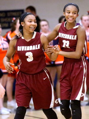 Sisters and teammates Anastasia Hayes (3) and Aislynn Hayes celebrate Riverdale's victory over Blackman in the Region 4-AAA girls semifinals. The two will compete in their first state tournament on Wednesday.