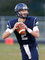 Central Catholic quarterback Avery Denhart drops back to pass against Eastern Greene Friday, September 16, 2016, at La Rocca Field. Denhart threw for five touchdowns as Central Catholic defeated Eastern Greene 52-13.
