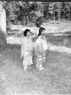 Two Mescalero Apache maidens ready for their coming of age ceremony have been identified. The two girls in the photograph by Carmon Phillips are Stella Marden, left, and Rosarita Smith.