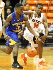 Dominic Artis, right, of the UTEP Miners tries to strip