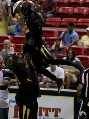 Wichita Falls Nighthawks' Jarve Dean lifts Tyler Williams