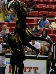 Wichita Falls Nighthawks' Jarve Dean lifts Tyler Williams in celebration after Williams scored a touchdown last season. The Nighthawks boasted the IFL's most explosive offense the last two seasons, but won't be playing in 2018.