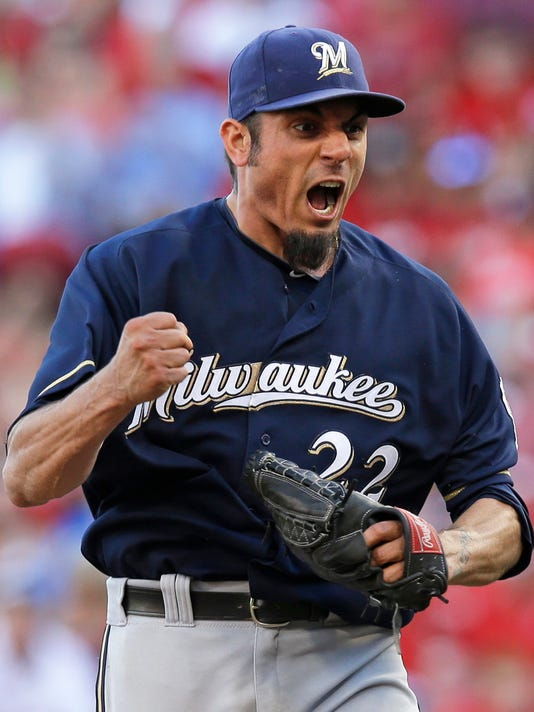 Milwaukee Brewers starting pitcher Matt Garza pumps his fist after they defeated the Cincinnati Reds 1-0 in a baseball game, Saturday, July 5, 2014, in Cincinnati. Garza threw a complete game shutout, allowing only two hits. (AP Photo/Al Behrman)