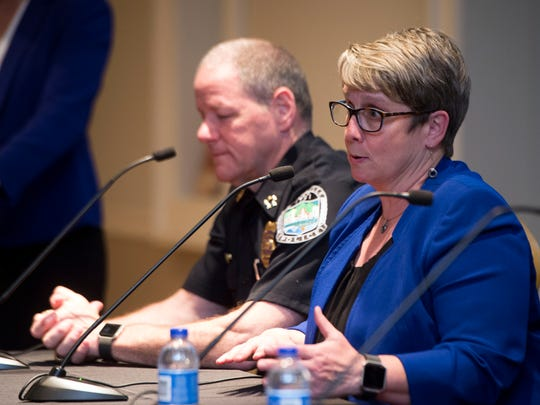 Dr. Martha Buchanan answers questions during a panel discussion on opiates and domestic violence on Wednesday, April 26, 2017 at the East Tennessee History Center. At left is Knoxville Police Chief David Rausch.