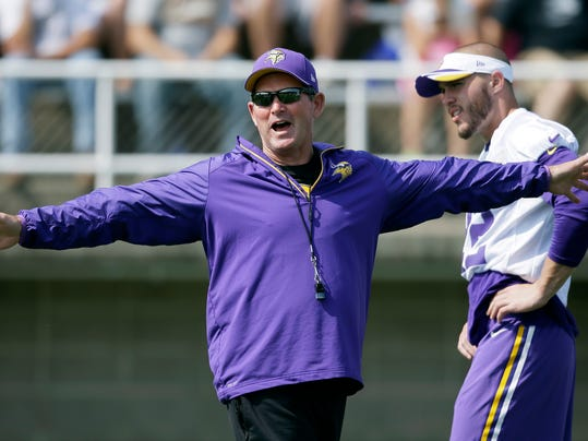 Minnesota Vikings head coach Mike Zimmer directs his team as free safety Harrison Smith, right, looks on during an NFL football training camp practice, Saturday, Aug. 2, 2014, in Mankato, Minn. (AP Photo/Charlie Neibergall)