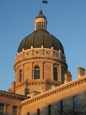 The Indiana Statehouse is warmly lit by the setting sun around 6 p.m. Wednesday, Feb. 20, 2008.