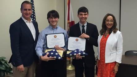 U.S. Rep. Mario Diaz-Balart and  Miami-Dade County School Board member Suzie V. Castillo honor Blake Anderson and William Pembleton from Gulf Coast High School for winning first place in the Congressional App Challenge.