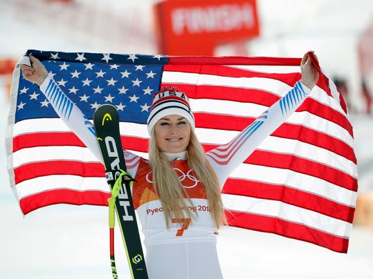 Bronze medal winner Lindsey Vonn, of the United States, celebrates during the flower ceremony for the women's downhill at the 2018 Winter Olympics in Jeongseon, South Korea, Wednesday, Feb. 21, 2018. (AP Photo/Christophe Ena)