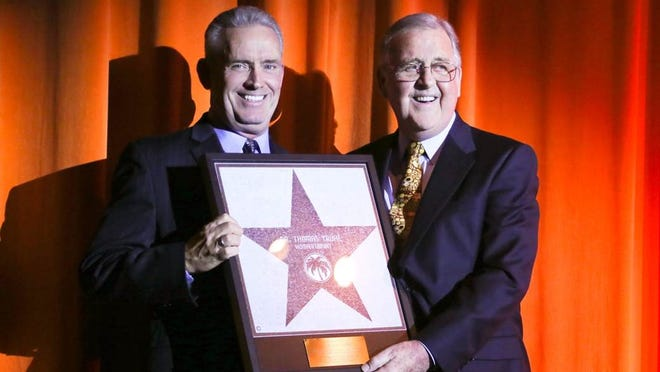 Palm Springs Art Museum Chairman Harold Meyerman, right, presented Annenberg Theater Council Chair Tom Truhe with a star on the Palm Springs Walk of Stars.