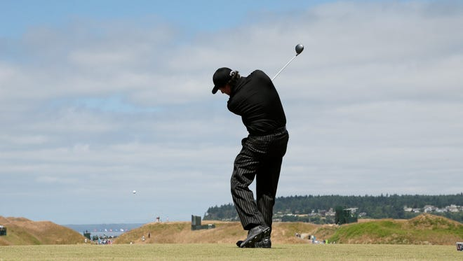 Phil Mickelson hits his tee shot on the 10th hole during a practice round for the U.S. Open golf tournament at Chambers Bay on Tuesday, June 16, 2015 in University Place, Wash.