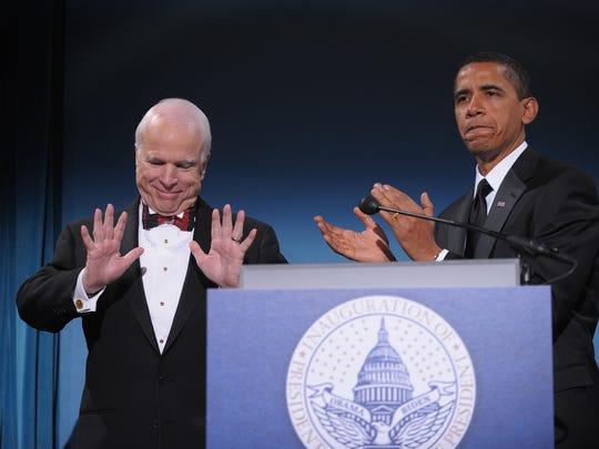 Then-President-elect Barack Obama applauds Arizona