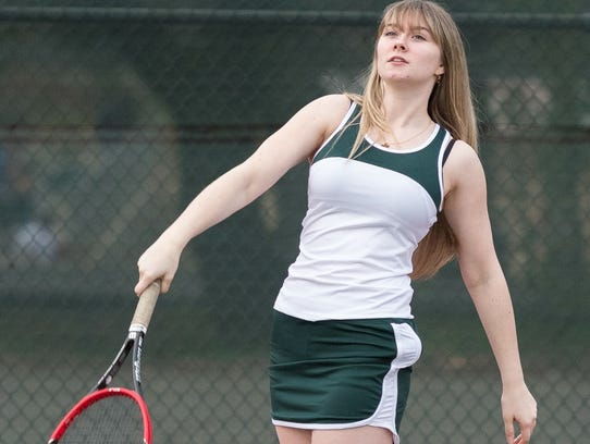 Shasta College freshman Abby Davis follows through