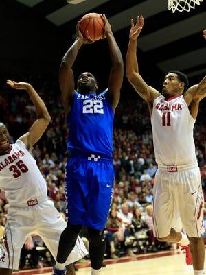 Jan 9, 2016; Tuscaloosa, AL, USA; Kentucky Wildcats forward Alex Poythress (22) goes to the basket as Alabama Crimson Tide forward Shannon Hale (11) defends at Coleman Coliseum.