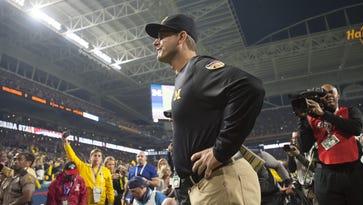 Michigan head coach Jim Harbaugh gets set for the Orange Bowl in December.