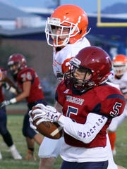 Ozzy Lopez (5) pulled in this Daniel Garcia pass to pick up big yardage for the Wildcats.