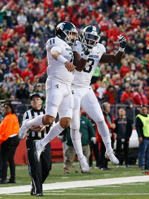 Nov 25, 2017; Piscataway, NJ, USA; Michigan State running backs Connor Heyward (11) and LJ Scott (3) celebrate a touchdown against Rutgers in the first half at High Point Solutions Stadium.