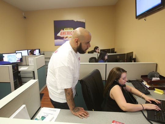 Pete Salcido, dispatch manager, helps Rachel McCaslin with a call into the American Cab dispatch center. American Cab is teaming with Walter Clark Legal Group to offer free rides in the Coachella Valley during the Fourth of July holiday.