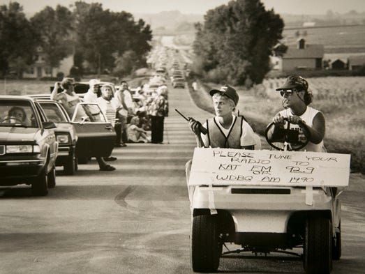 """Iowa casting director Sue Riedel directed the traffic during the filming of the night-time car line for the ending scene of """"Field of Dreams"""" in Dyersville in 1988."""