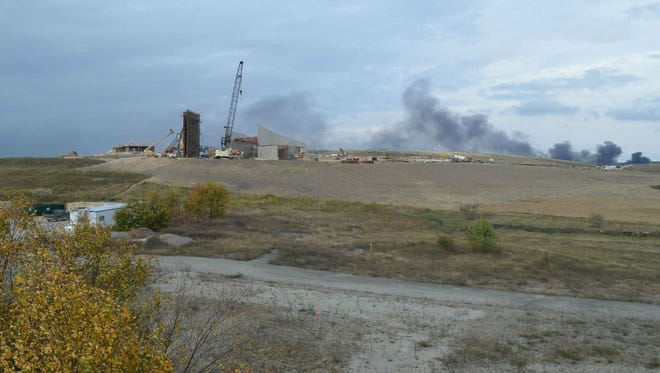 Smoke billows during a fire at the Flight 93 National Memorial in Shanksville, Pa., on Friday, Oct. 3, 2014, grew to include both the Flight 93 park office and park headquarters. The cause of the fire is still undetermined.