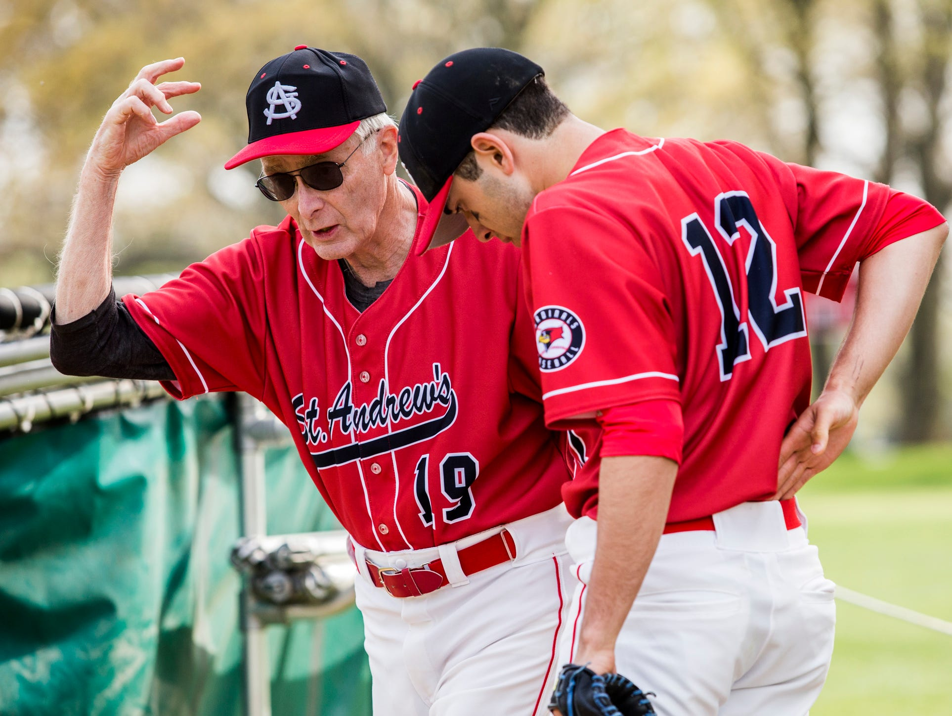 St. Andrew's head coach Bob Colburn talks starting pitcher Colin Cool before the start of a game at St. Andrew's School in Middletown on Thursday afternoon.